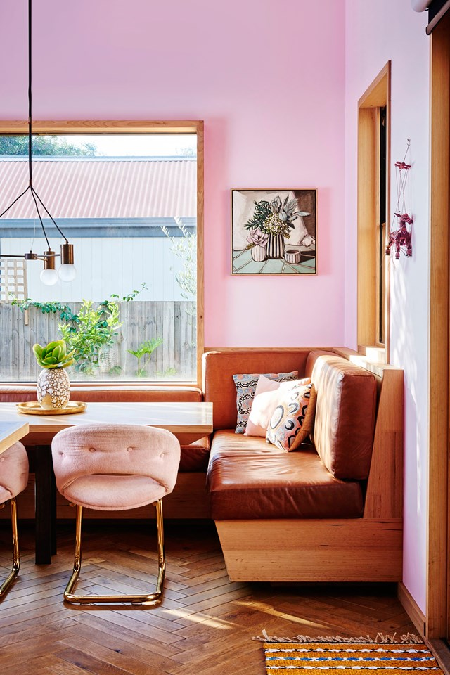 "This corner of the kitchen in *Kip & Co* co-founder [Hayley Pannekoecke's colourful home](https://www.homestolove.com.au/kip-and-co-co-founder-hayley-pannekoeckes-colourful-home-6044|target=""_blank"") is a cosy spot for family mealtimes. The tan leather benches are custom-made and the light is from Jardan, as are the pink velvet and brass armchairs."