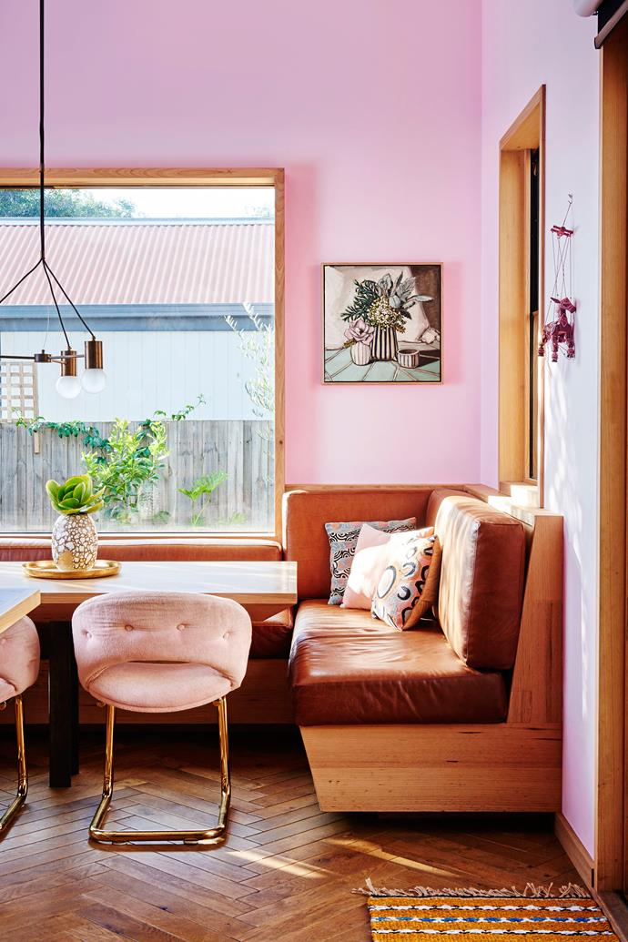 This corner of the kitchen is a cosy spot for family mealtimes. The tan leather benches are custom-made and the light is from Jardan, as are the pink velvet and brass armchairs.