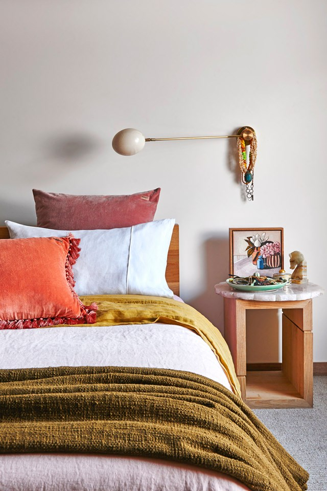 "**Mustard and pink:** The 70s are back, baby and [Kip & Co co-founder Hayley Pannekoecke's colourful home](https://www.homestolove.com.au/kip-and-co-co-founder-hayley-pannekoeckes-colourful-home-6044|target=""_blank"") is here to prove it. Earthy mustard tones paired with dusty pinks and a pop of orange, create a warm and inviting space where we'd be happy to retreat. *Photo:* Nikole Ramsay"