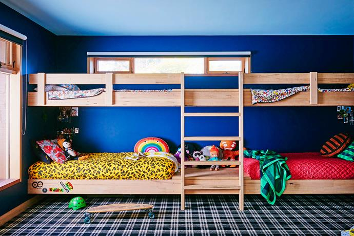 "The walls in the boys' bedroom have been painted in ""Copen Blue"" and the ceiling in ""Blue Wash"" by Haymes Paint – a great backdrop for their bespoke ""pirate ship"" bunk bed."