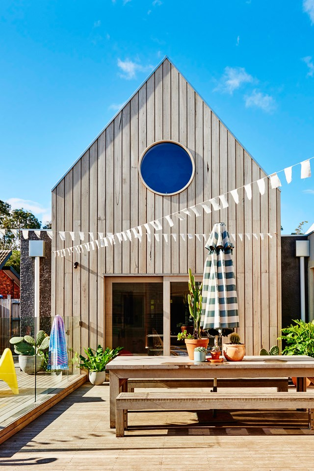 "[Kip & Co co-founder Hayley Pannekoecke's home](https://www.homestolove.com.au/kip-and-co-co-founder-hayley-pannekoeckes-colourful-home-6044|target=""_blank"") has a Scandinavian look from the exterior with steep-pitched roof, round windows and hardwood timber cladding that has been left to weather naturally."
