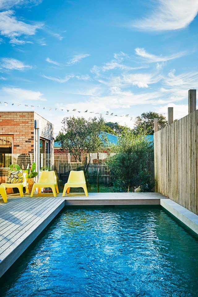 Bright yellow VÅGÖ chairs from IKEA and a playful pop of colour to this pool area. *Photo:* Nikole Ramsay
