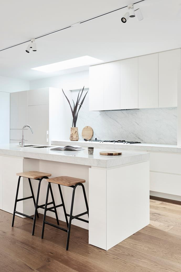 Carrara marble benchtop and splashback. Tapware, Methven. Stools, Hunting for George. Vase, Established for Design. Custom kitchen by Fine Edge Cabinets.