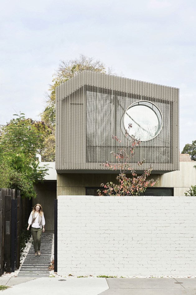 "To achieve a minimal Japanese aesthetic, clean lines and natural finishes were used to form the façade of this [modern industrial Melbourne home](https://www.homestolove.com.au/melbourne-japanese-industrial-home-6051|target=""_blank""). The off-form concrete walls have been imprinted with wooden slats to create a timber-like texture to create a connection to nature. Photo: Eve Wilson / *Australian House & Garden*"