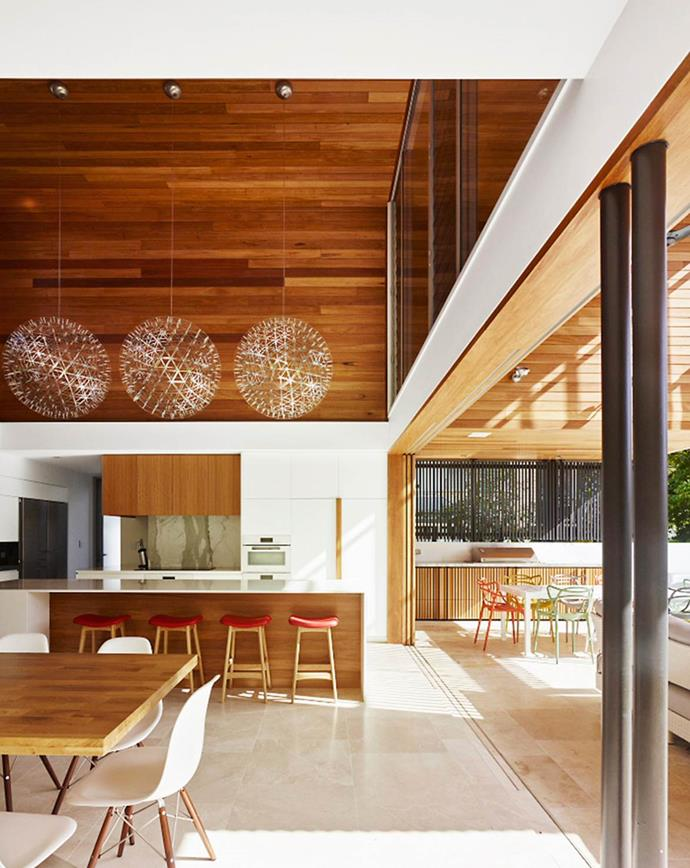 **GREAT HEIGHTS** <br><br> Rich blackbutt timber wraps the walls and continues on the ceiling, inside and out, reinforcing the connection between indoors and outside. A soaring 5.5m ceiling is integral to this Brisbane kitchen, designed by architect Shaun Lockyer as a 'breathable' space that embraces its subtropical climate. *Photo: Australian House & Garden*