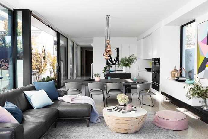 """We have quite a minimalist style,"" says Nathan. To keep things out of sight, there's custom-built storage on most of the long wall. The Calligaris 'Tarsio' extension table and 'Duffy' chairs are  from Voyager Interiors. Tom Dixon pendant lights."
