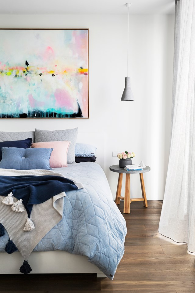 "This pretty pastel bedroom in a [modern Melbourne home](https://www.homestolove.com.au/house-designed-for-an-odd-shaped-block-6069|target=""_blank"") feels cosy because of its luxurious linen and gorgeous tasseled throw. If you like a soft, fuss-free quilt cover, look no further than one made of jersey. *Photo: Martina Gemmola / Story: Australian House & Garden*"