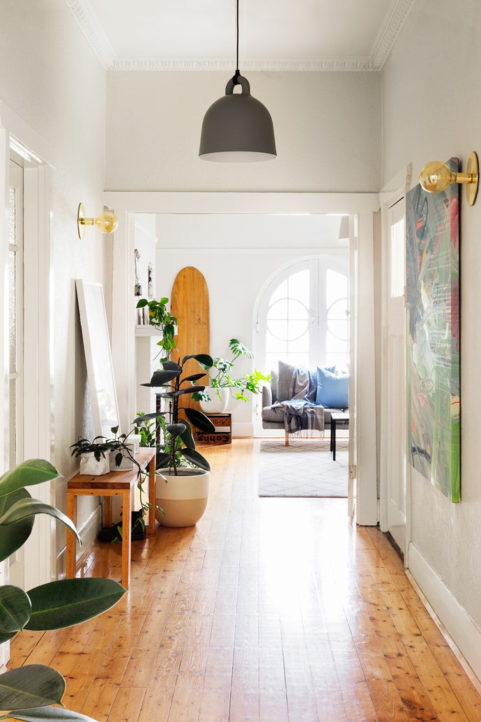 Adding colourful artworks, plants galore and updating the lights has helped the couple make the home their own. The sconces are from Dowel Jones.