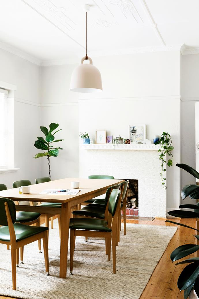 """Lucy bought the dining chairs from the side of the road for $100. The Armadillo&Co rug and Normann Copenhagen """"Bell"""" pendant lamp are both from [Hunting For George](https://www.huntingforgeorge.com/ target=""""_blank"""" rel=""""nofollow"""")"""