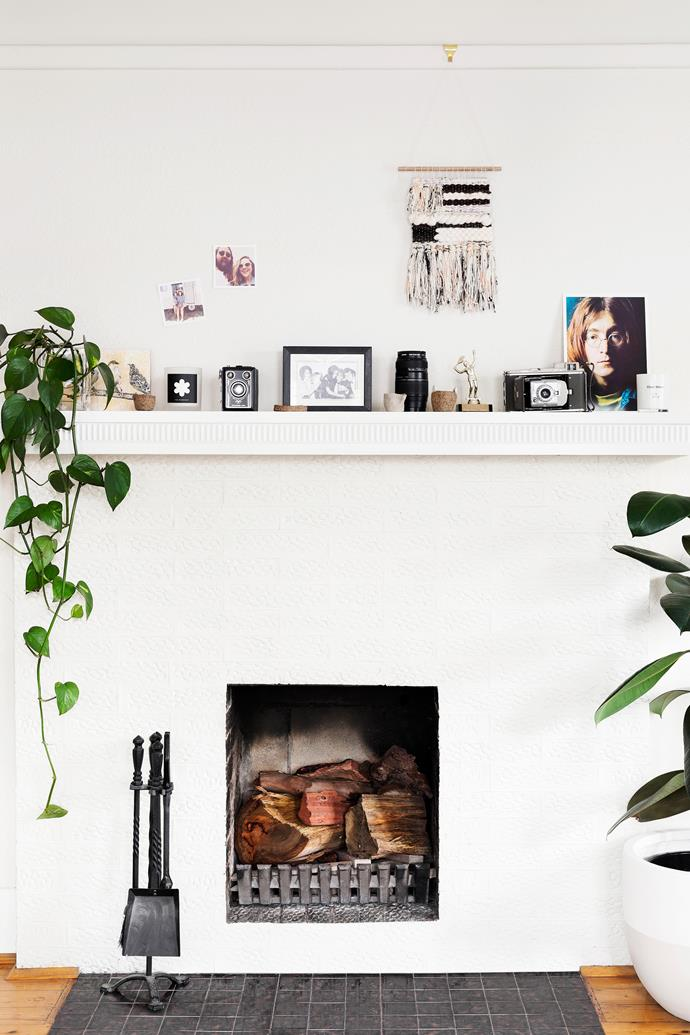 Everything on the mantelpiece has sentimental value, from Lucy's first tennis trophy to her beloved John Lennon portrait. She handmade the weaving herself.