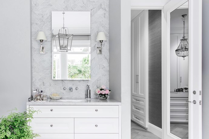 The clean white colour scheme in the 'hers' ensuite is anything but minimal.