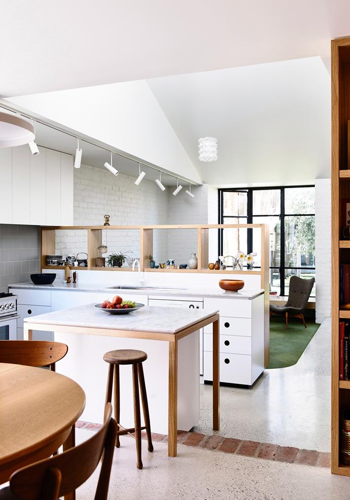 A central workspace allows multiple people to be in the kitchen at once and on either side of the bench.