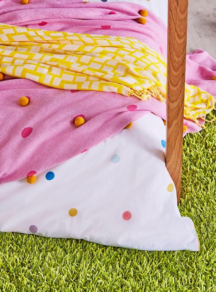 Astra throw rug in Zest, $74.95, from Rapee. Kip & Co Wattle Pom Pom blanket, 90cm x 100cm, $89, from Kip & Co.