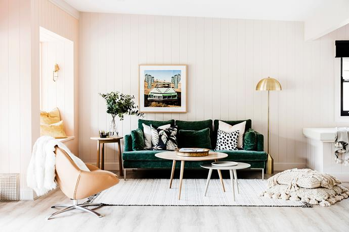 Inspired by their surroundings, Three Birds opted for a forest green BoConcept sofa to blend in with the bush setting. An artwork by Lauren Webster, BoConcept coffee tables, rug and armchair, and a Gallery Home floor lamp complete the picture.