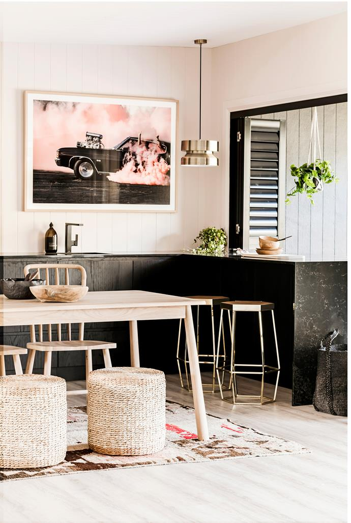 With such a small space to work with, the girls had the kitchen (opposite) custom made by Carrera by Design. It features Fisher & Paykel appliances, a Caesarstone benchtop in Vanilla Noir and Luxaflex aluminium shutters. The artwork is by Simon Davidson.
