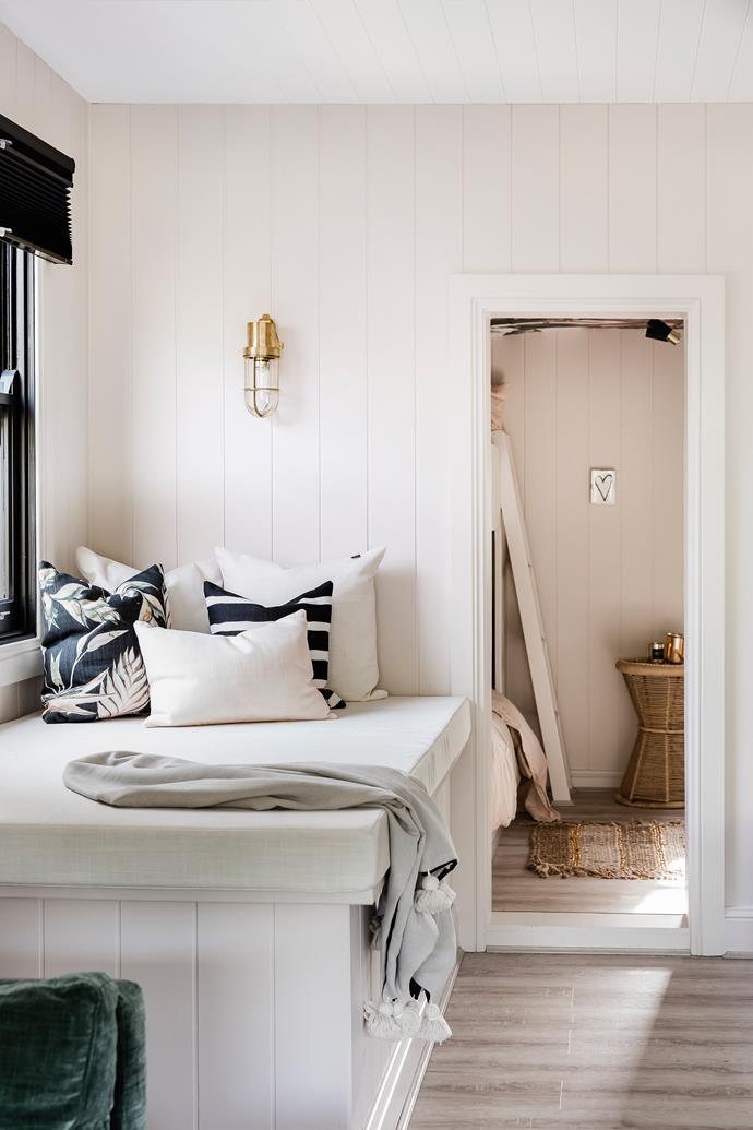 "Just one example of using available space for a multitude of purposes, this window seat converts to a bed at night, with handy storage underneath. The walls have been painted in Dulux ""Parchment Paper"", the custom cushions are by Grace Garrett and the tasselled throw is from Sea Tribe."