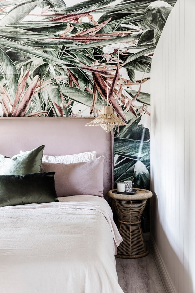 "In an eye-catching move, the walls and curved ceiling of this bedroom are covered with Watercolour Strelitzia wallpaper from [Luxe Walls](https://www.luxewalls.com.au/|target=""_blank""