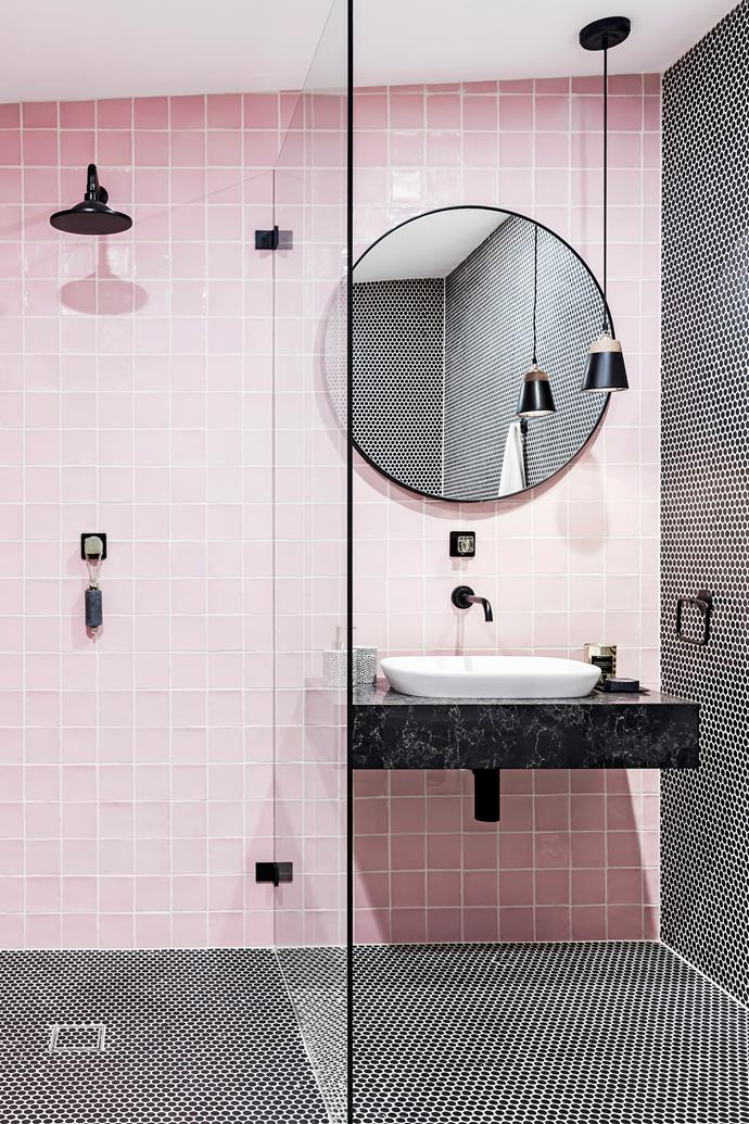 Black details add some edge to an otherwise feminine pink bathroom – think penny rounds from Amber Tiles, a Caroma showerhead, Dorf mixer tap and Caesarstone vanity top in Vanilla Noir. The pink feature wall tiles are also from Amber Tiles.