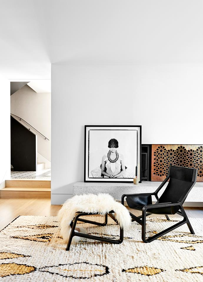 A custom-made fire screen in copper-plated steel by Astor Metal Finishes is a focal point. 'Toro' chair from Blu Dot, with lambskin from Jardan. Tribal print from Les Interieurs.