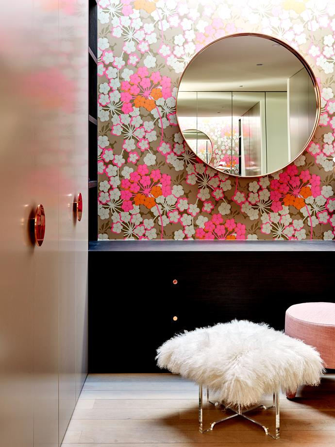 In the dressing room, Osborne & Little 'Rosabella' wallpaper from Seneca. Custom copper mirror by Tina & Louise. 'Kelly' ottoman from Jardan. Jonathan Adler Mongolian lamb bench from Coco Republic.