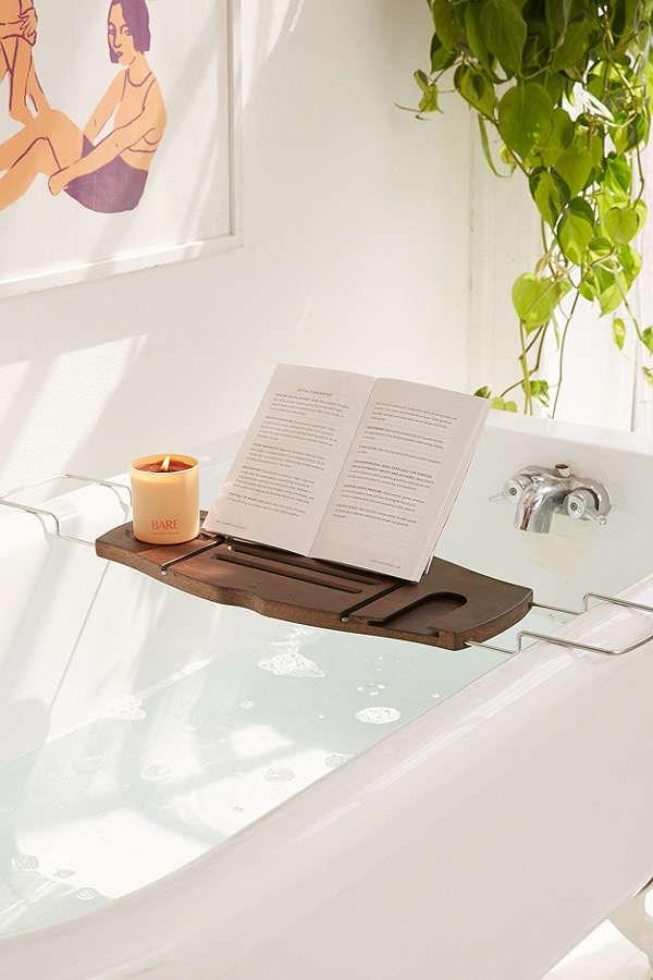 'Me Time' Bamboo Bath Tray Caddy, $49, [Urban Outfitters](https://www.urbanoutfitters.com/shop/me-time-bamboo-bath-tray-caddy?adpos=1o3&cm_mmc=SEM-_-Google-_-PLA-_-18283950120&color=022&creative=86505403744&device=c&gclid=EAIaIQobChMIwaPz3P7x1wIVgiQrCh08dwFREAQYAyABEgKIGPD_BwE&inventoryCountry=AU&matchtype=&mrkgadid=2996055061&mrkgcl=671&network=g&product_id=43364900%20022%200000&rkg_id=h-678690e1b1828b78560cb5ecffb9736d_t-1512446633&utm_campaign=Google&utm_content=18283950120&utm_medium=paid_search&utm_source=SEM&utm_term=AU%20-%20GSC%20-%20All%20Product)