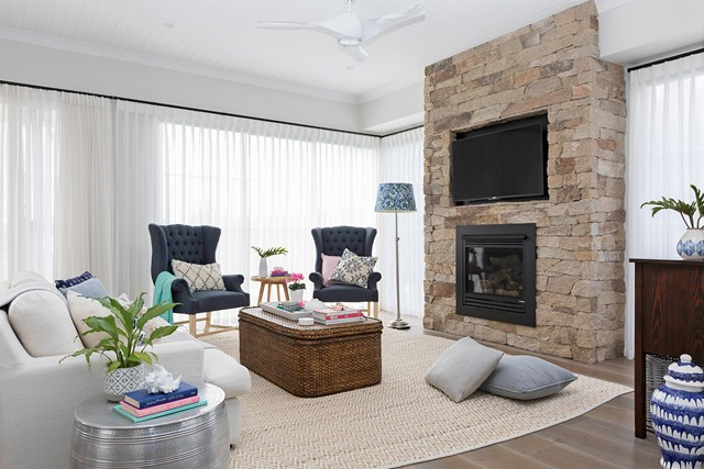 """A dry-stone chimney breast was laid by a local mason in the living room of this [Hamptons style Queenslander home](https://www.homestolove.com.au/hamptons-style-queenslander-home-6107