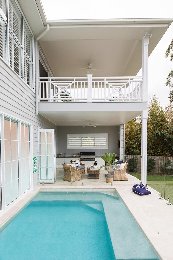 Glass panels around the pool create a seamless look while also meeting safety requirements.