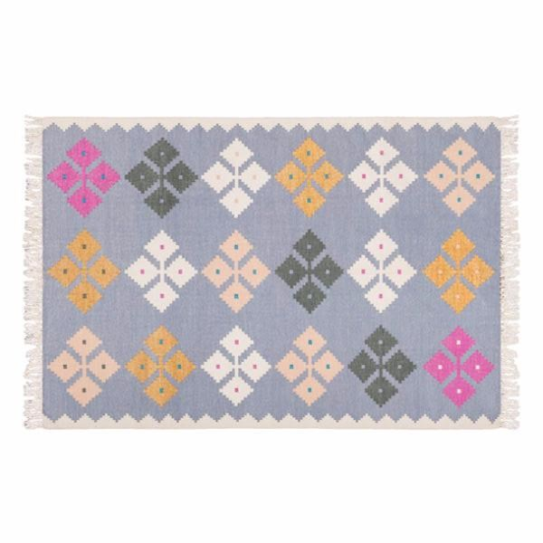 "Amigos De Hoy 'Petal' rug (small) in Lilac/Peach, $795, [Design Twins](https://www.designtwins.com/collections/rugs/products/petal-rug-small-lilac-peach|target=""_blank""