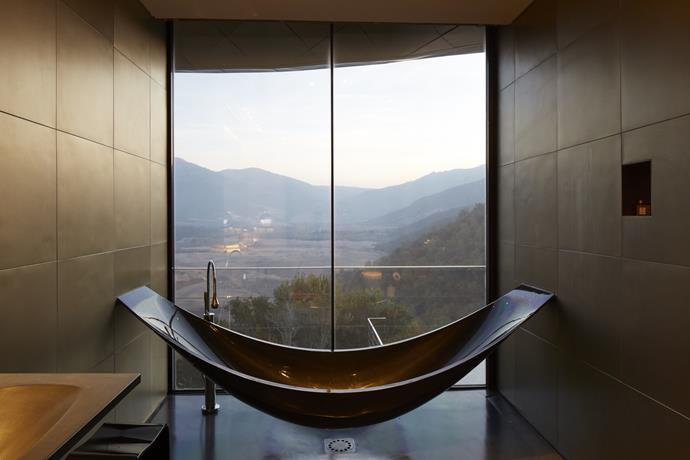 **VIK Master Suite, Viña Vik, Millahue, Chile** <br><br> Bathe while overlooking technicolour valleys and wineyards in Millahue, Chile.