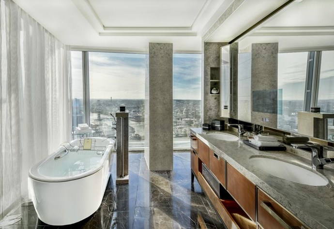 **Deluxe King Room with City Views, Shangri-La Hotel at The Shard, London, UK** <br><br> With views over the London skyline, the Shangri-La Hotel at The Shard offers marble-clad bathrooms with underfloor heating, separate bath tubs, a glass-enclosed shower and floor-to-ceiling windows showcasing the sprawling city below.