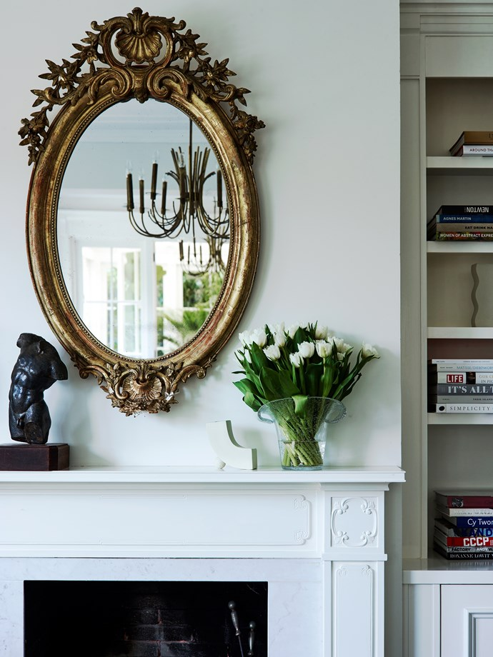 Antique sculpture on mantelpiece. Pendant light (reflected in mirror) from The Country Trader.