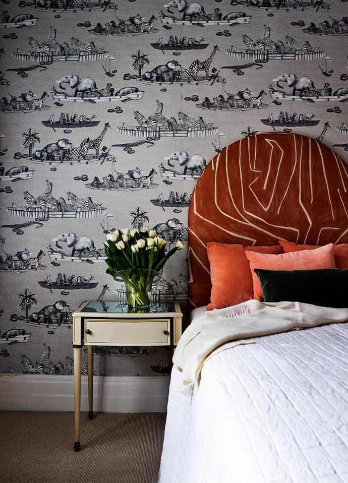 Kelly Wearstler bedhead against Cole & Son wallpaper in a bedroom.