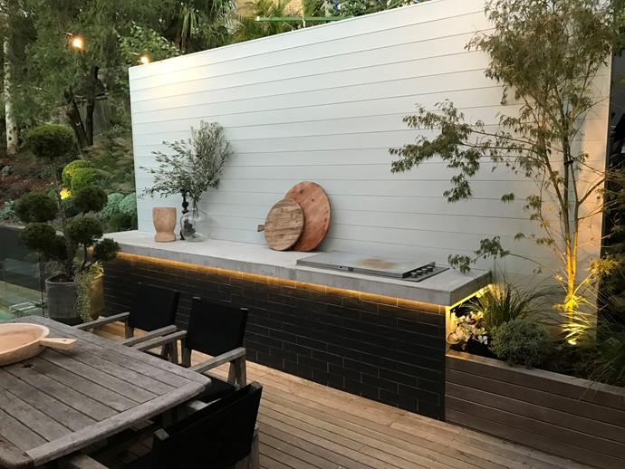 LED strip lighting can help make an outdoor kitchen a usable space at night, all while adding a party vibe. *Photo: Jason Busch*