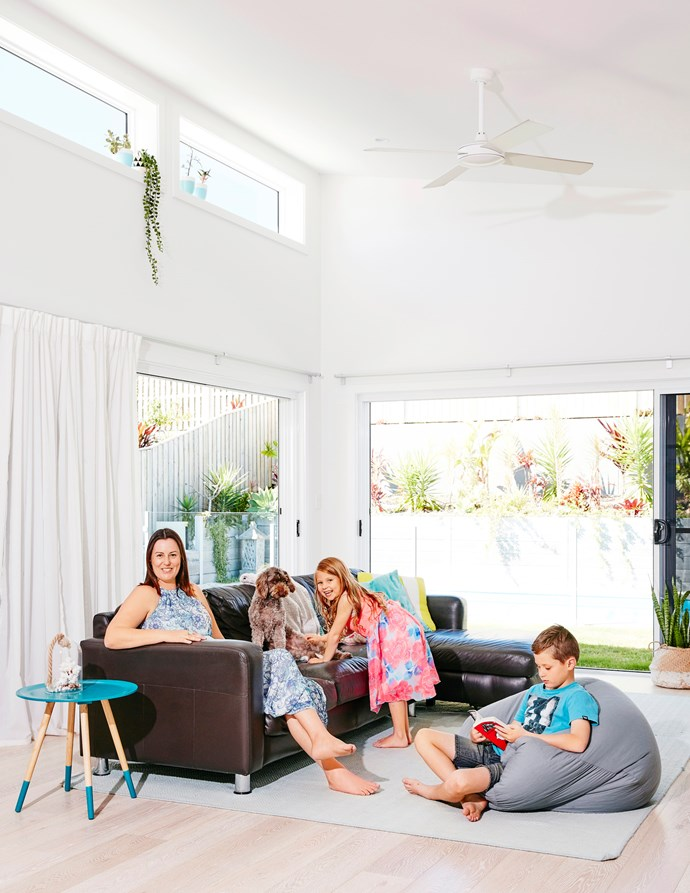 High ceilings and windows create a grand, bright open space. Alisha and the kids use this space to relax and play games.