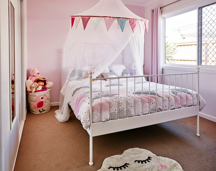 Lily's room is made magical with a canopy and pretty pink bed linen. Bed from Ikea.