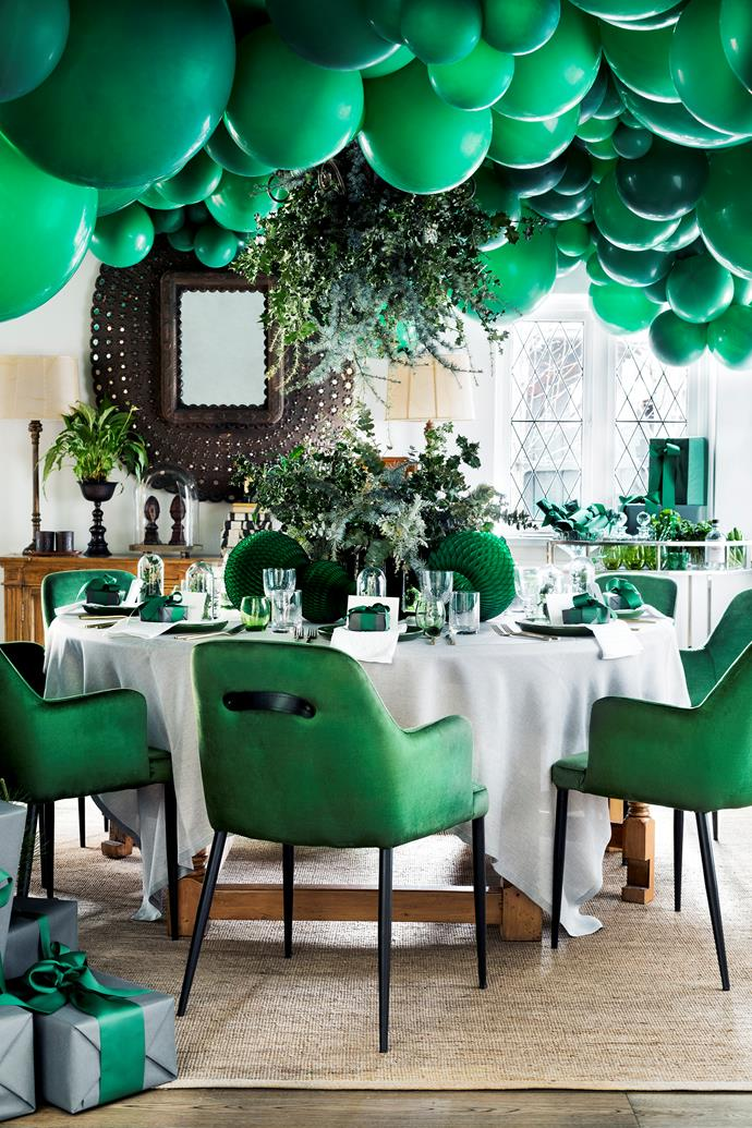 A sea of green balloons creates a showstopping display.