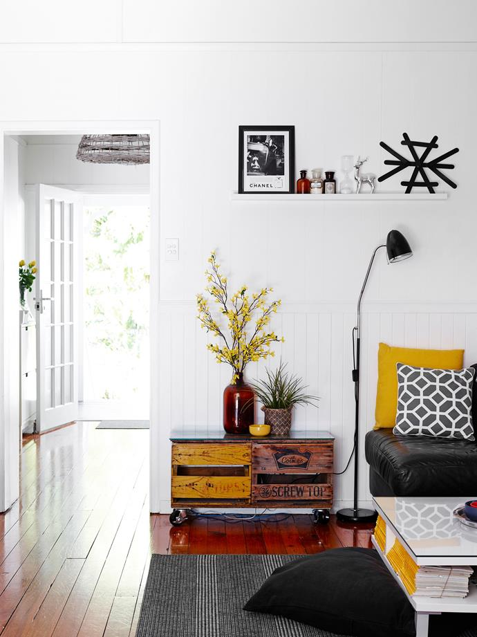 "White timber tongue and groove paneling, rich wooden flooring and a side table made from old crates provides contrast and warmth against the crisp white walls in this [charming weatherboard Noosa home](https://www.homestolove.com.au/gallery-charming-weatherboard-home-renovation-in-noosa-1618|target=""_blank""