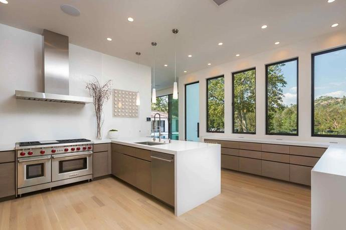 Naturally, the mansion comes equipped with two kitchens - a dedicated chefs kitchen, and a staff kitchen and prep area. Fitted with top of the line appliances, including a double oven and dishwasher, this staff kitchen is all about functionality.