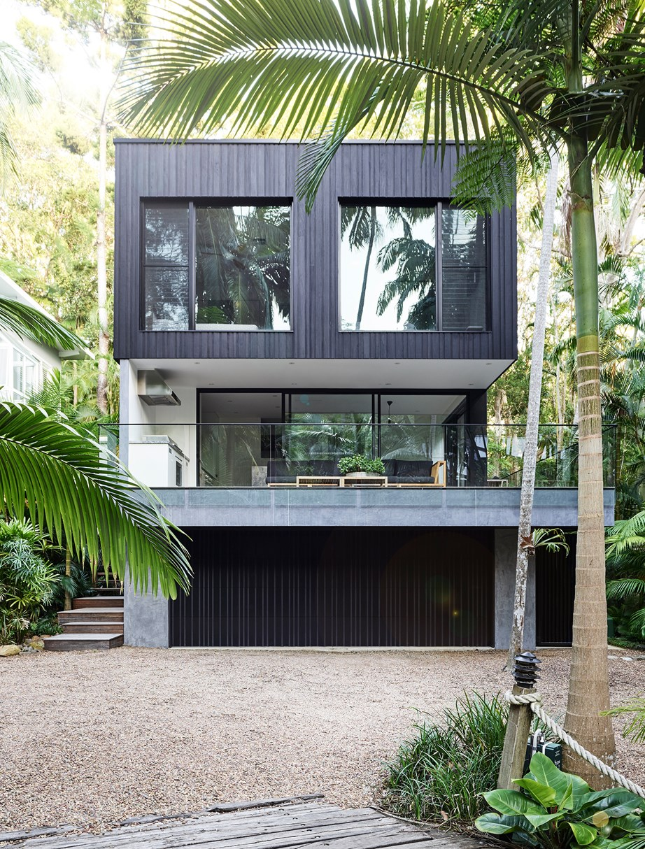 "Paint isn't the only way to embrace the dark exterior trend. Here, treated, stained hardwood cladding links this [holiday house in Noosa](https://www.homestolove.com.au/a-luxury-noosa-holiday-home-by-mim-design-6146|target=""_blank"") to its rainforest surroundings, helping it to recede rather than compete."