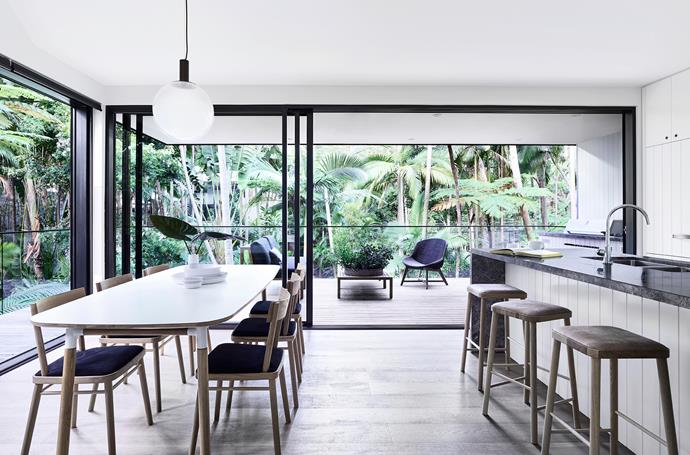 The rainforest is an ever-changing backdrop to this generous open space. 'Form' dining table, from Normann Copenhagen. Chairs, from Green Cathedral.