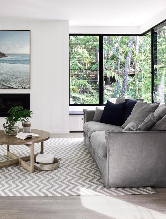 Large wraparound windows put nature squarely in the frame. Sofa, vase and stone vessel, all from Coastal Living.