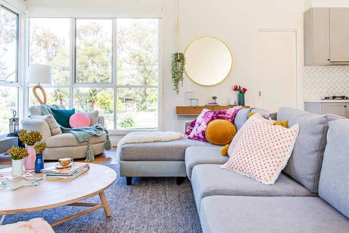 The living area's large windows create a bright space with a view to the family's expansive property.