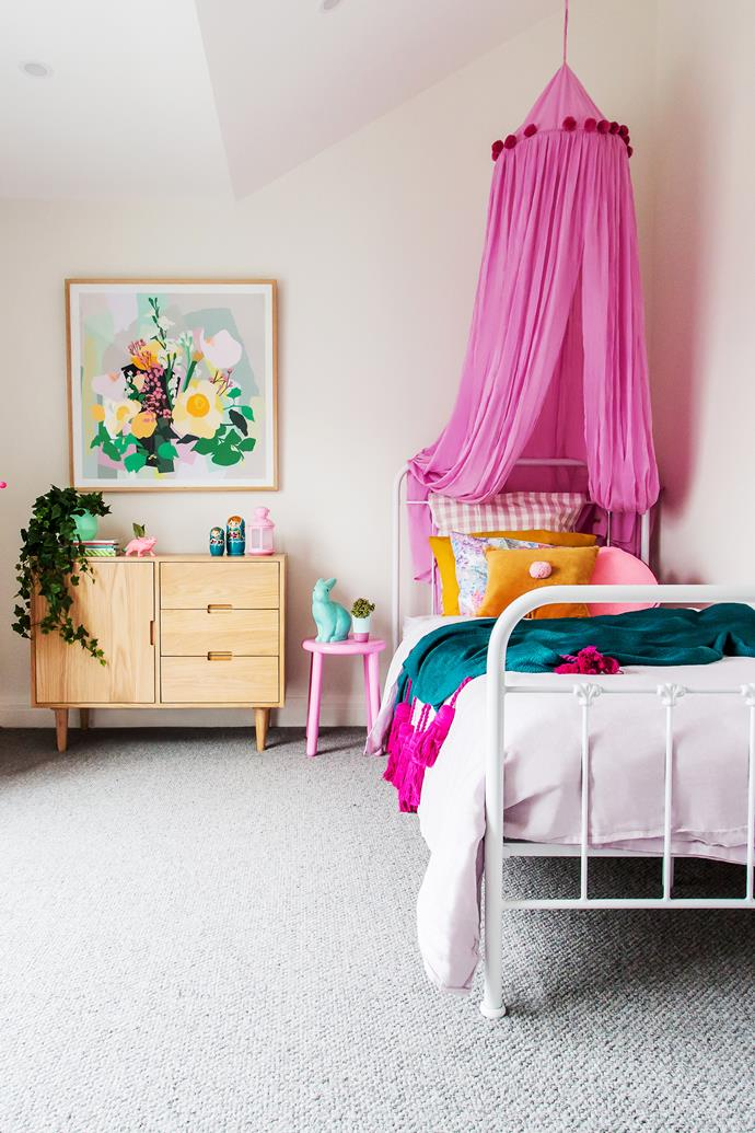 Chloe's bedroom is an explosion of colour and fun. 'London Flowers' art print from Leah Bartholomew