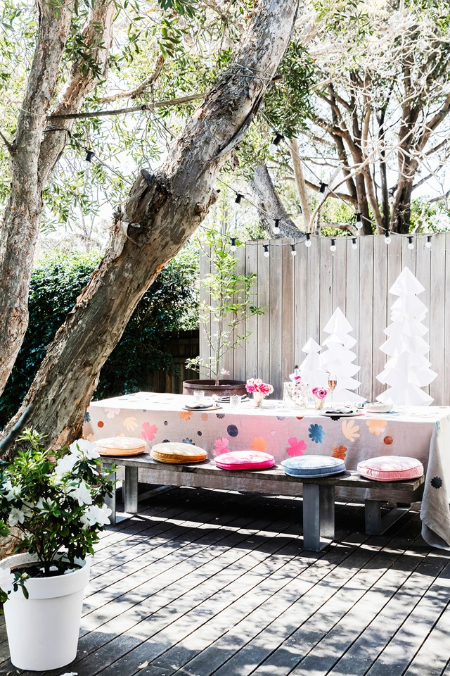 "Get more longevity out of your entertaining zone with lighting that sets the mood when the sun goes down. Strings of lights can add a magical, welcoming vibe. [Rachel Castle's gorgeous home](http://www.homestolove.com.au/rachel-castles-colourful-and-quirky-sydney-home-4729|target=""_blank"") and garden is the perfect spot for a party. ""To me, an Aussie Christmas is all about the glorious sunshine,"" she says."