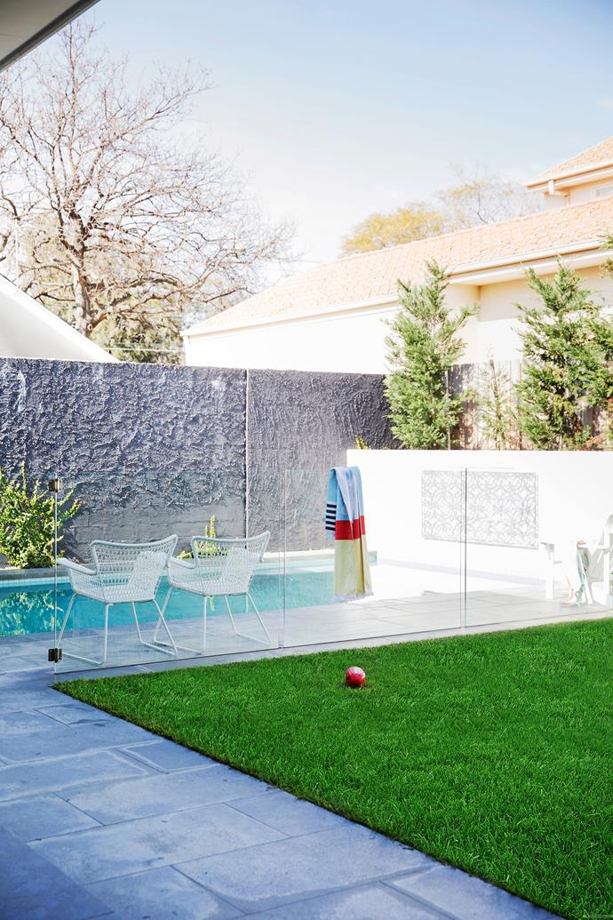 A textured wall adds visual interest to this small pool as well as providing wind protection.