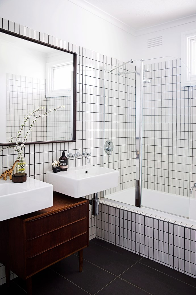Grey grout creates contrast and depth in a space that would otherwise be all-white.