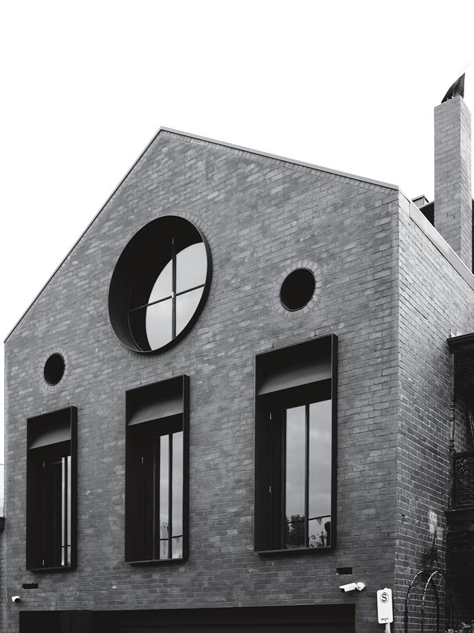 New windows, including a circular one on the top  floor, define the street-side facade.