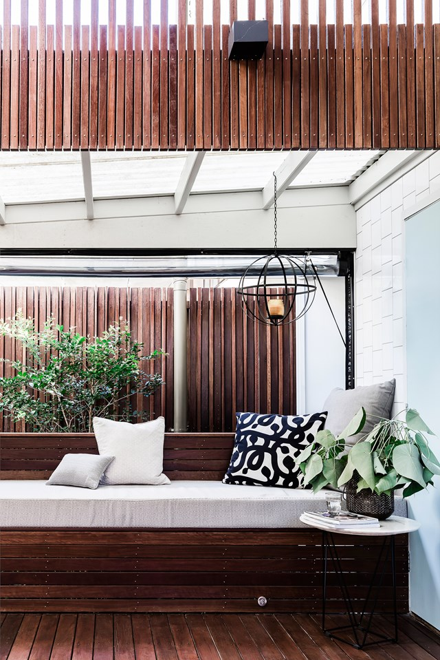 Roll-up, bistro-style blinds protect this outdoor window seat from the elements, making it an inviting space whatever the weather. Photo: Maree Homer