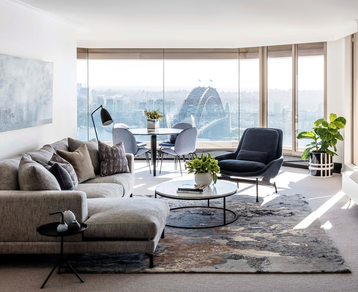 The 'Flower Ash Black' rug from The Rug Establishment anchors the living room and was the inspiration for the painterly palette throughout. Kett 'Addis' modular sofa and 'Hoop' co ee table with Carrara marble top and bronze powdercoat frame, both from Cosh Living.