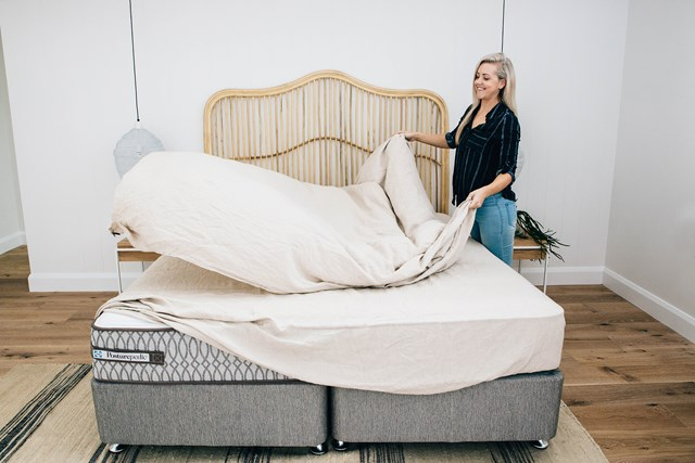 """Kara styling up a storm in the guest bedroom of their [Toowoon Bay Home](https://www.homestolove.com.au/inside-kyal-and-kara-toowoon-bay-home-6339